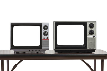 Two vintage televisions isolated on white with cut out screens. 版權商用圖片
