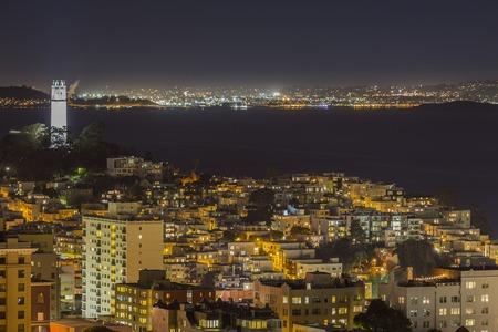 San Francisco Bay, Coit Tower Park and Telegraph Hill community at night.