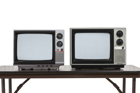 Two vintage televisions on table isolated on white. 版權商用圖片
