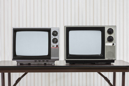 Two vintage televisions on table. 版權商用圖片