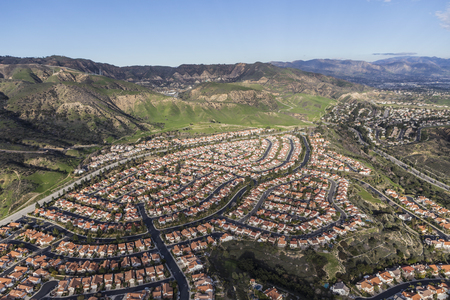 Suburban houses and streets in the Porter Ranch neighborhood of Los Angeles.  Stock Photo