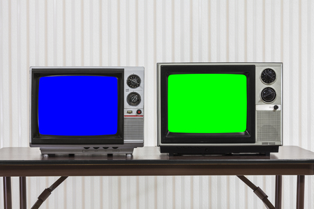 Two vintage televisions with chroma key blue and green screens. 版權商用圖片
