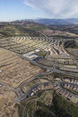 suburban neighborhood: Aerial view of Porter Ranch construction and Oat Mountain in the City of Los Angeles, California.   Stock Photo