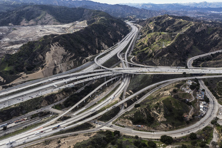 Aerial view of the Golden State 5 and Antelope Valley 14 freeway interchange in the Newhall Pass in Los Angeles County, California.