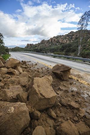 land slide: Storm related landslide blocking Santa Susana Pass Road in the San Fernando Valley area of Los Angeles, California.
