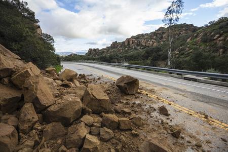 Rock slide blocking Santa Susana Pass Road in the west San Fernando Valley area of Los Angeles, California.