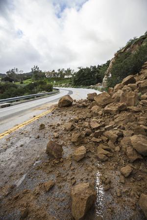 Storm damage rocks blocking Santa Susana Pass road in the San Fernando Valley area of Los Angeles, California. Stock Photo