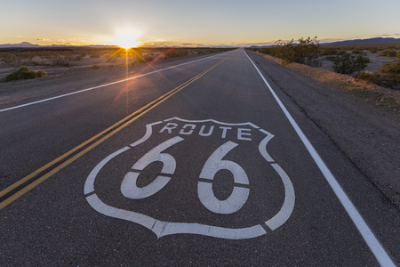 Route 66 highway sign sunset in the California Mojave Desert.   Stock Photo