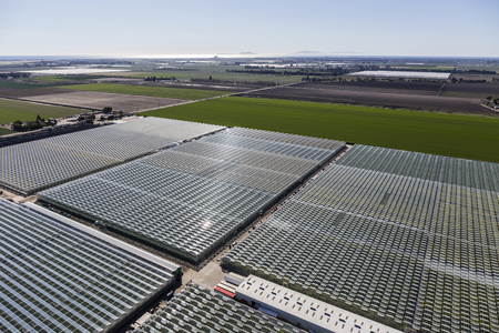 Aerial view of farmland and commercial greenhouses in Southern California.