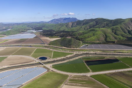 Aerial view of farm fields and Santa Monica Mountains National Recreation Area in Ventura County, California.   Stock Photo