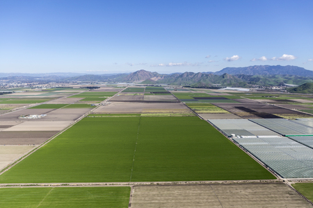 Aerial view of farm fields and Santa Monica Mountains Parks near Camarillo in Ventura County, California.  Stock Photo