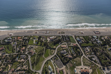zuma: Aerial view of Zuma Beach, suburban streets, homes and estates in scenic Malibu, California. Stock Photo