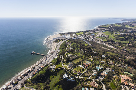Aerial view of Pacific Ocean view estates and pier in Malibu, California.