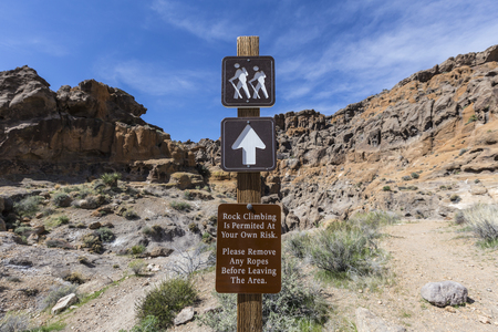 Trail and rock climbing sign at the Mojave National Preserve in Southern California.
