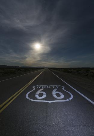 Desert moon over Route 66 sign in eastern San Bernardino County, California.