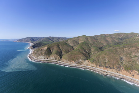 Aerial view of Pacific Coast Highway near Sycamore Cove north of Malibu California.