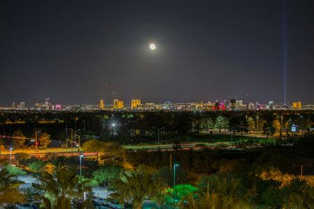 nv: Las Vegas, Nevada, USA - May 13, 2017:  Night view of Las Vegas strip resort towers with moon.