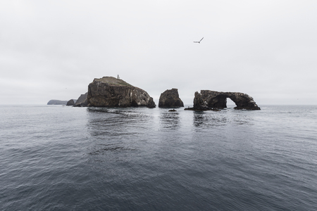 Anacapa Island with calm water and clouds at in Channel Islands National Park in Southern California. Stock Photo