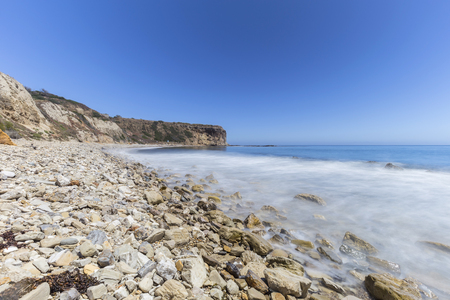 Rocky coast with blurred water motion at Abalone Cove Shoreline Park in Ranch Palos Verdes, California. Stock Photo