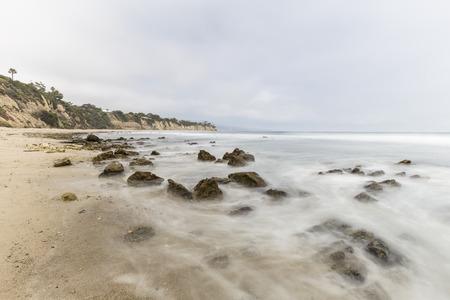 Dume Cove tidal pool rocks with motion blur in Malibu, California. Stock Photo