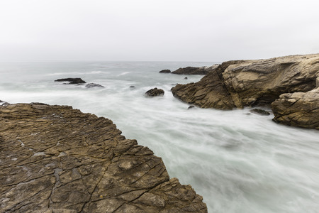 Motion blur sea water flowing from rocky cove at Leo Carrillo State Beach in Malibu, California. Stock Photo