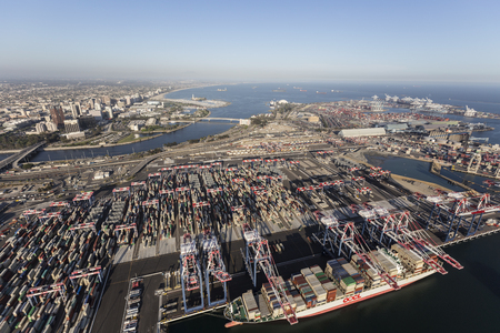 Long Beach, California, USA - July 10, 2017:  Aerial view of port cargo terminals and downtown Long Beach near Los Angeles, California.