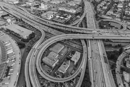 Los Angeles, California, USA - July 21, 2016:  Black and white dusk aerial of the Santa Monica 10 and Harbor 110 freeway interchange near downtown Los Angeles.