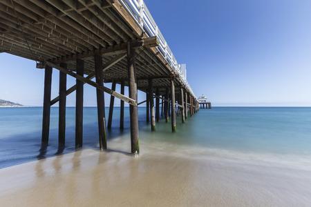 santa monica: Malibu Pier Beach with motion blur pacific ocean water near Los Angeles in Southern California.   Stock Photo
