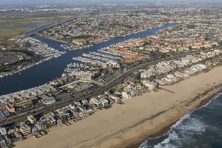 Aerial of Sunset Beach ocean front homes in Orange County California. Фото со стока