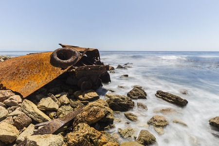 Historic shipwreck with motion blur surf in Rancho Palos Verdes, California.