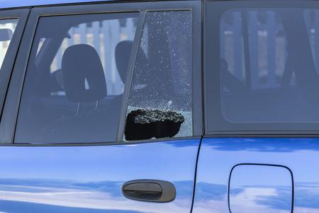 Shattered car window from vehicle burglary.
