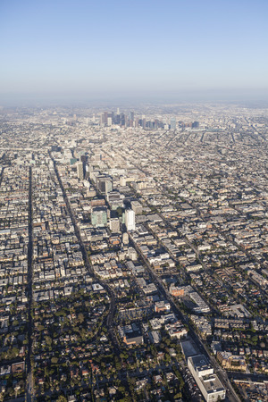 Smoggy summer afternoon aerial view of the Wilshire Blvd and downtown Los Angeles in Southern California.   Stock Photo