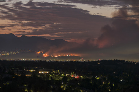 Dawn view of the La Tuna wildfire burning on Verdugo Mountain near Burbank.