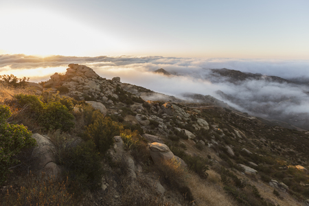 Dawn clouds at Rocky Peak Park above the San Fernando Valley in Los Angeles, California. Stock Photo