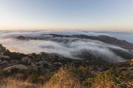 counties: Morning fog in the Santa Susana Pass between Los Angeles and Ventura Counties in Southern California.  View shot from Rocky Peak Park.