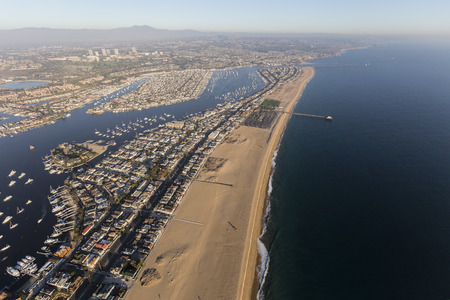 Aerial view of Newport Beach Harbor, Balboa Bay, nearby homes and parks.