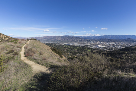 Griffith Park hiking trail above Los Angeles and Glendale in the Santa Monica Mountains of Southern California. Stock Photo