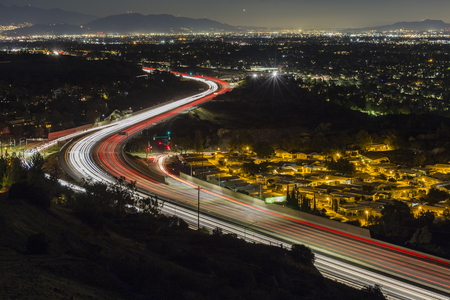 Night view of route 118 freeway entering the San Fernando Valley in Los Angeles, California.