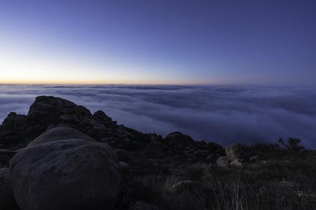 Dawn view above coastal fog at Rocky Peak Park near Los Angeles California.   Stock Photo
