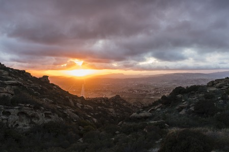 Winter storm clouds with sunset above Simi Valley in Ventura County near Los Angeles California. Stock Photo