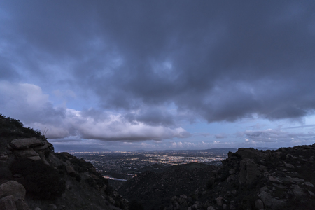 Stormy winter sky after sunset above the San Fernando Valley in Los Angeles California.  Shot from Rocky Peak Park in the Santa Susana Mountains near Simi Valley. Stock Photo