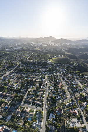 Vertical aerial view of suburban homes and streets in Thousand Oaks, California.   Stock Photo