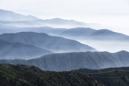Layers of misty ridges in the San Gabriel Mountains in Los Angeles County, California Stock Photo