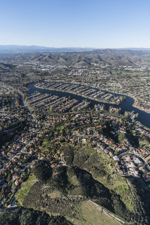 Vertical aerial view towards Westlake Island in the Thousand Oaks and Westlake Village communities in Southern California.