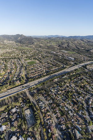Vertical aerial view of suburban residential neighborhoods near Route 23 freeway in Thousand Oaks, California.