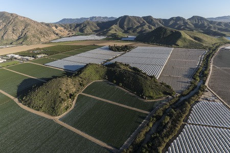 Aerial view of coastal farm fields and Santa Monica Mountains foothills near Camarillo in scenic Ventura County, California.