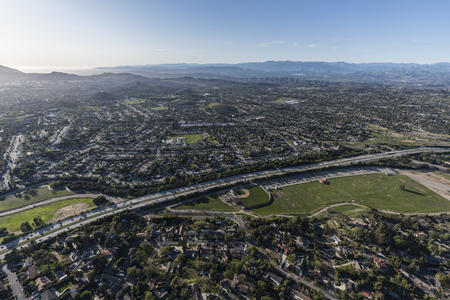 Aerial view of route 23 freeway, sports fields and homes near Los Angeles in suburban Thousand Oaks, California.
