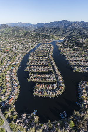 Vertical aerial view of Westlake Island and lake in Thousand Oaks and Westlake Village communities in Southern California.