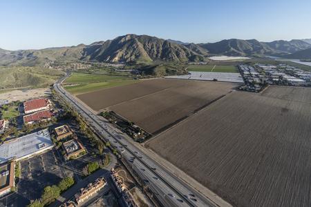 Aerial view of buildings, farm fields and Ventura 101 Freeway in Camarillo, California.