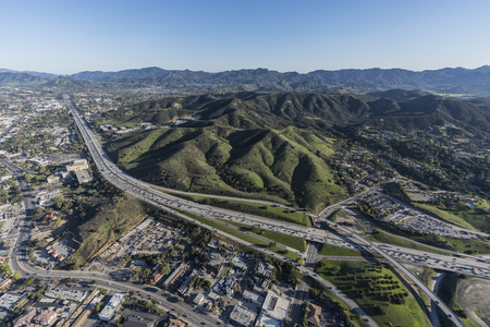 Aerial view of Ventura 101 Freeway and suburban Thousand Oaks near Los Angeles in scenic Southern California.
